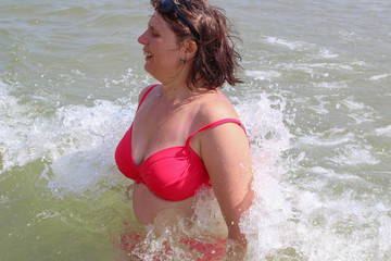 wave covers the woman,woman playing in the sea waves
