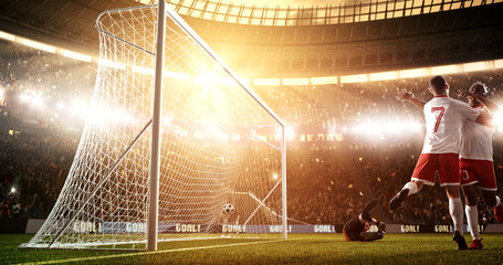 Intense soccer moment in front of the goal on the professional soccer stadium.