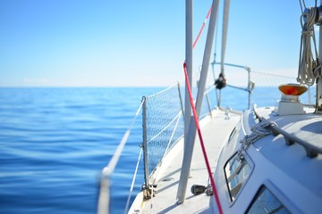 A view from the sailboat's deck to the bow on a clear day, close-up, Norway