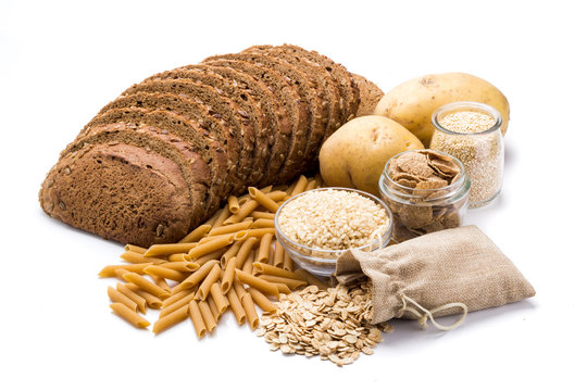 Group of whole foods, complex carbohydrates isolated on a white background