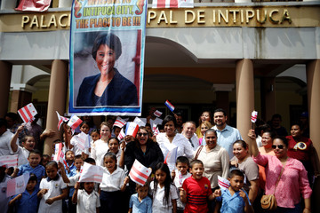 Washington D.C. mayor Muriel Bowser poses for a picture with students during her visit to Intipuca, El Salvador