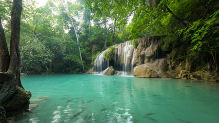 Wonderful green waterfall and nice for relaxation, Breathtaking and amazing turquoise water at the evergreen forest,