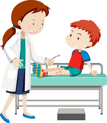 Doctor helping young boy with sore leg