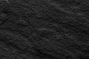 Black stone wall rough surface.