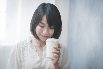 the girl is drinking coffee