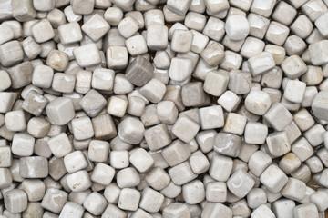 Close up white cube gravel background