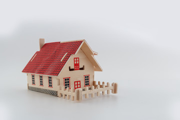 Toy home wood  with fence on white background