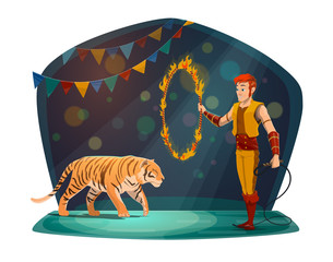 Handler with tiger jumping in fire on circus arena
