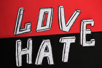 written word love  on a red background and hate on a black background
