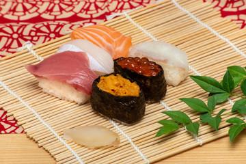 sushi set on white bamboo sheet