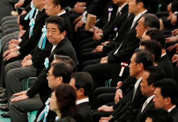 Japan's Prime Minister Shinzo Abe attends a memorial service ceremony marking the the 73rd anniversary of Japan's surrender in World War Two, at Budokan Hall in Tokyo