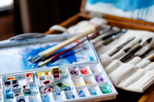 watercolor palette and brushes. artist tools instruments and inks for creative leisure. painting lessons concept