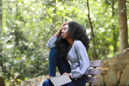 Sorrowful black woman with electronic reader