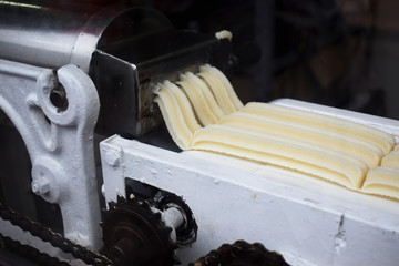 machine in the dough factory, for cooking churros