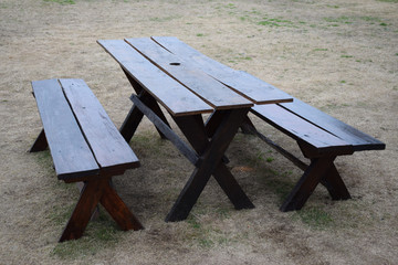 wooden bench with table in a street restaurant