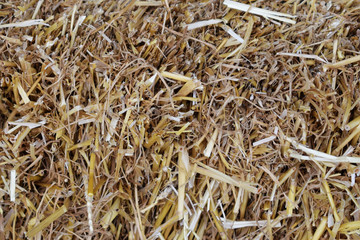 background of dried straw grass, close-up