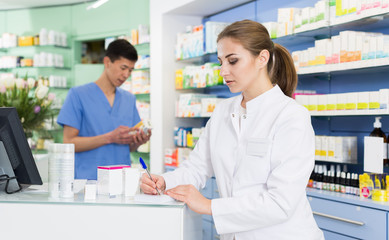 Woman pharmacist is inventorying remedies