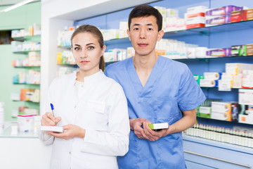 Man and woman is standing with medicines