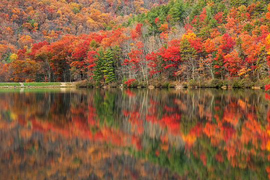 Vibrant autumn scene & water reflections along Sherando Lake within the George Washington National Forest near Lyndhurst, Virginia (USA).