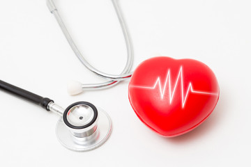 Red heart and a stethoscope. Isolated on white background. Studio lighting. Concept for healthy and medical