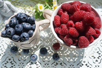 fresh blueberries and raspberries on a wooden tray