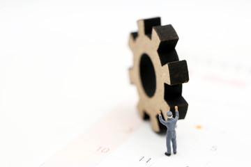 Miniature people : Worker and tool with Calendar Using for concept Calendar Adjustment Day.