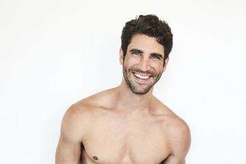 Shirtless dude smiling to camera