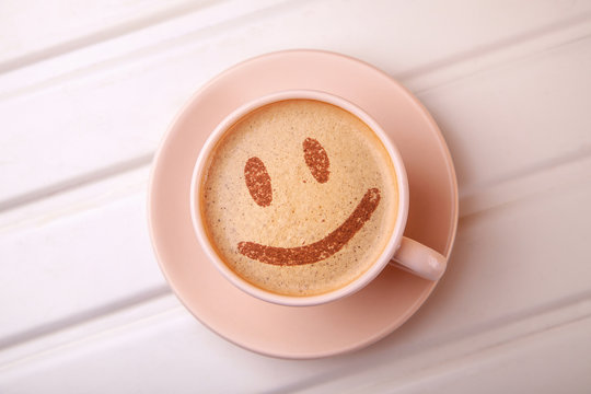 Cup of coffee with smile face on foam. I like coffee break