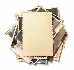Stack old photos isolated on white background. Mock-up blank paper