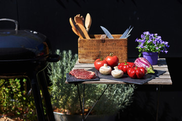 Preparing fresh beef steak with vegetables ready for the grill. Place for outdoor relaxing for a barbecue.