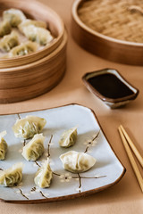 Asian gyoza, dumplings snack, chopsticks, steamer