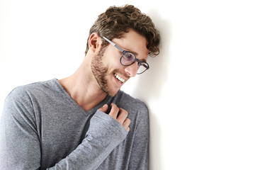 Happy guy in glasses and grey top, smiling