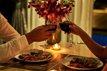 Happy couple on summer evening having romantic dinner.