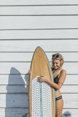 Woman Surfer Holding a Board