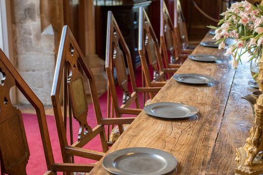 Medieval dining table and chairs. Mediaeval fraternal banqueting hall.