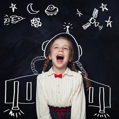 Little girl astronaut having fun. Kids imagination and childhood dreams concept