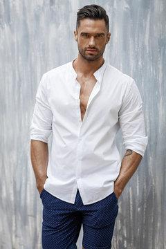 Portrait of handsome man in white shirt
