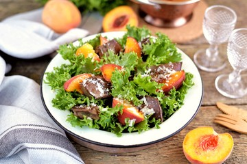 Salad with fried turkey liver, peaches, parmesan, olive oil and balsamic vinegar.