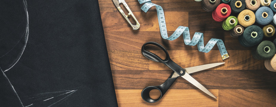 sewing tools on the wooden table