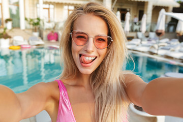 Attractive young woman in swimsuit, sunglasses