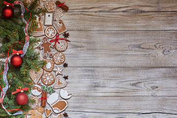 Christmas Holiday Background with copy space. Homemade cookies, Christmas fir, tree and Christmas spices.