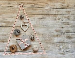 Christmas tree made of Christmas decor and gift box. Top view.