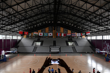 An official takes a picture inside the Basketball Hall, inside the Gelora Bung Karno sports complex, ahead of the 2018 Asian Games in Jakarta