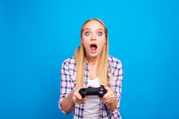 Close up of shocked and attractive blond woman holding joystick