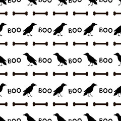 Seamless pattern with black ravens, bones and words Boo on the white background