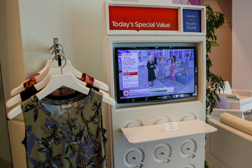 Products are displayed next to a screen broadcasting live at the QVC Studio Park in West Chester, Pennsylvania