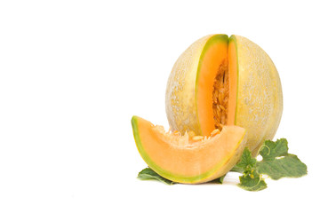 Ripe organic Cantaloupe melon with leaves isolated on a white background.space for your text.