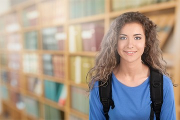 Young student girl in library
