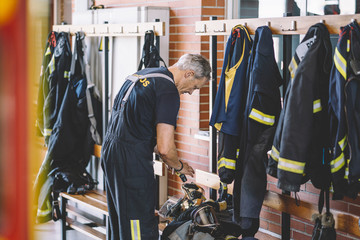 Firemen getting dress at looker room in fire station