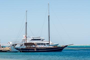 Bright sunny sea with a yacht